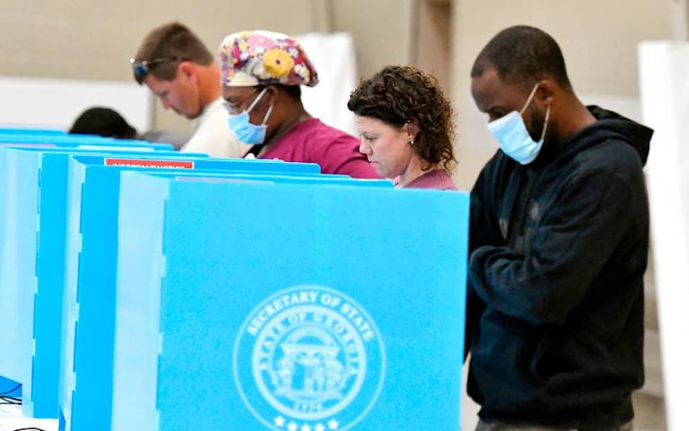 Voters cast their ballots at Mikado Baptist Church in South Bibb County Tuesday afternoon. Photo provided by The Macon Telegraph. (JASON VORHEES / JVORHEES@MACON.COM)