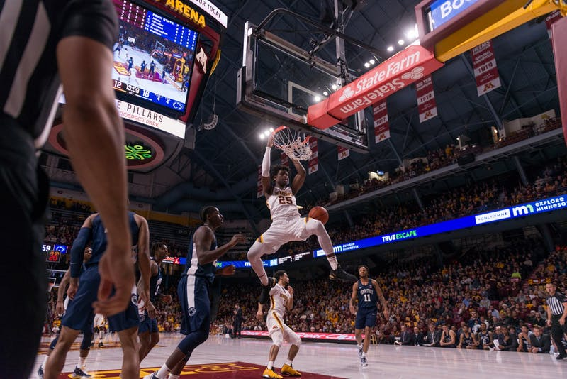 Gophers Center Daniel Oturu dunks the ball at Williams Arena on Wednesday, Jan. 15.  Minnesota defeated the Penn State Nittany Lions 75-69. (Kamaan Richards / Minnesota Daily)