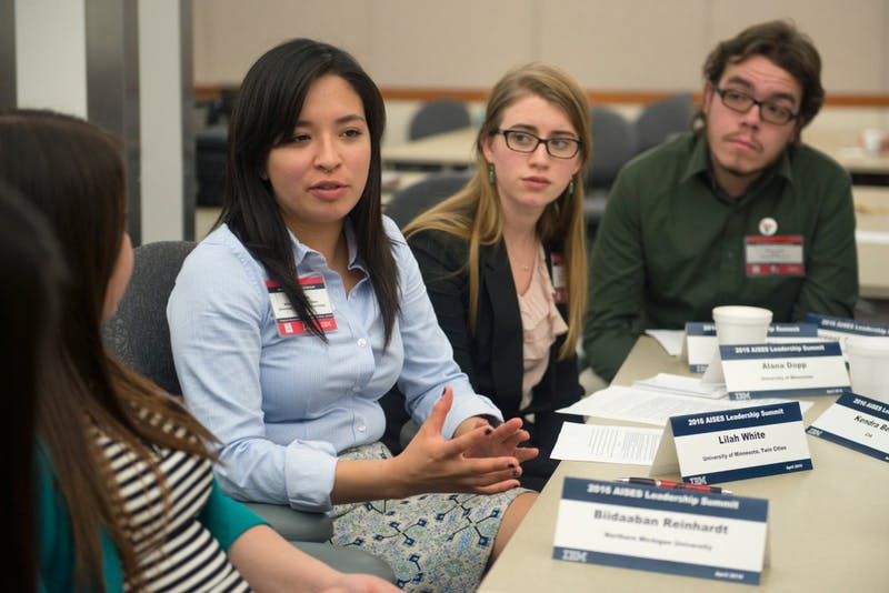 University of Minnesota student Lilah White speaks to a small group during a session at the American Indian Science and Engineering Society's Leadership Summit at IBM in Rochester on Saturday.
