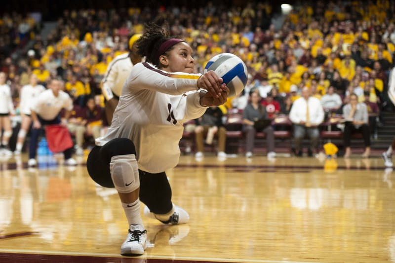 Outside Hitter Alexis Hart dives for the ball at the Maturi Pavilion on Friday, Nov. 22. The Gophers took Nebraska to five sets but ultimately fell 3-2.