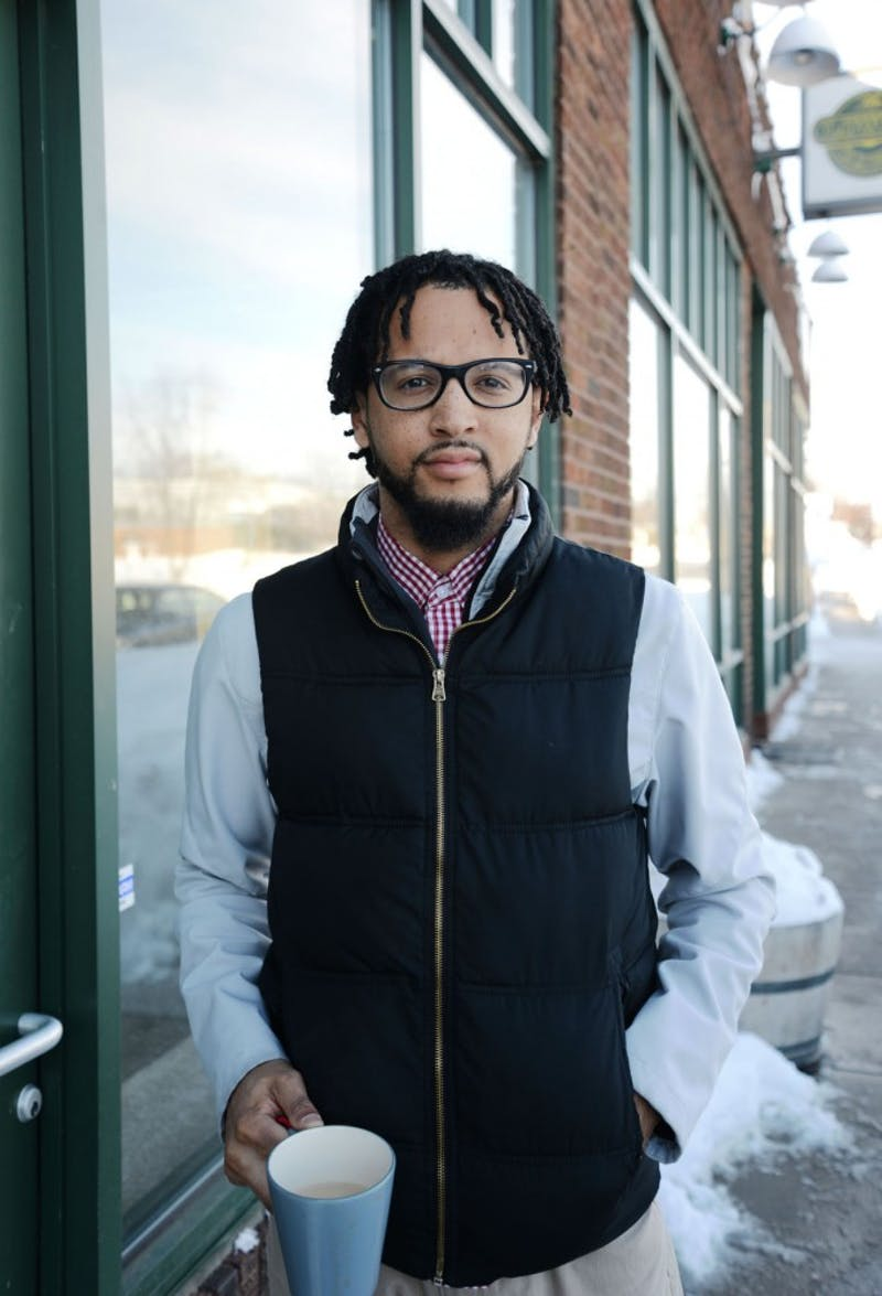 Local poet and activist Chaun Webster stands outside of his future bookstore in north Minneapolis on Tuesday. Webster and his wife are opening the only bookstore in the neighborhood, and it will only sell work by authors of color.