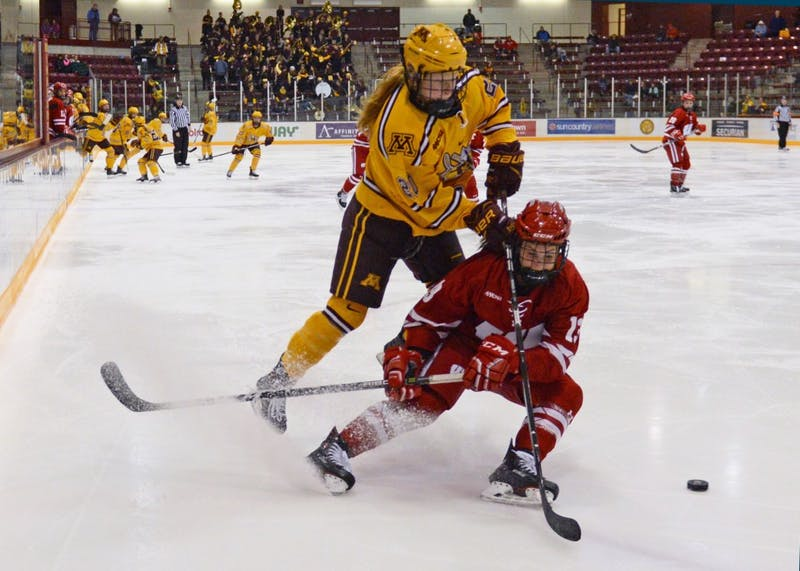 Forward Alex Woken goes after the puck during the Gophers' game against Wisconsin at Ridder Arena on Sunday, Oct. 29.