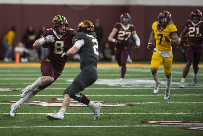 Sophomore Thomas Rush intercepts the ball for a touchdown on Saturday, April 13 at the football facility in Athlete's Village. The Gopher football team participated in their annual spring football game.