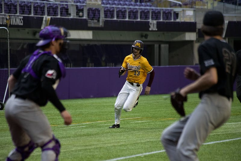 Outfielder Otto Grimm rounds third base during the Gophers' 7-6 win against Texas Christian University at U.S. Bank Stadium on Saturday, Feb. 23.