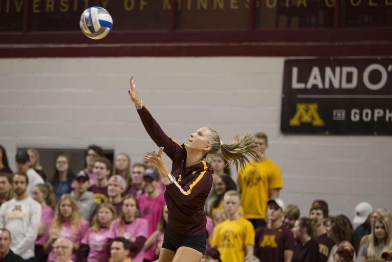 Freshman libero CC McGraw serves the ball during the game against the Northwestern Wildcats on Saturday, Oct. 13. The Gophers beat Northwestern in all three sets.