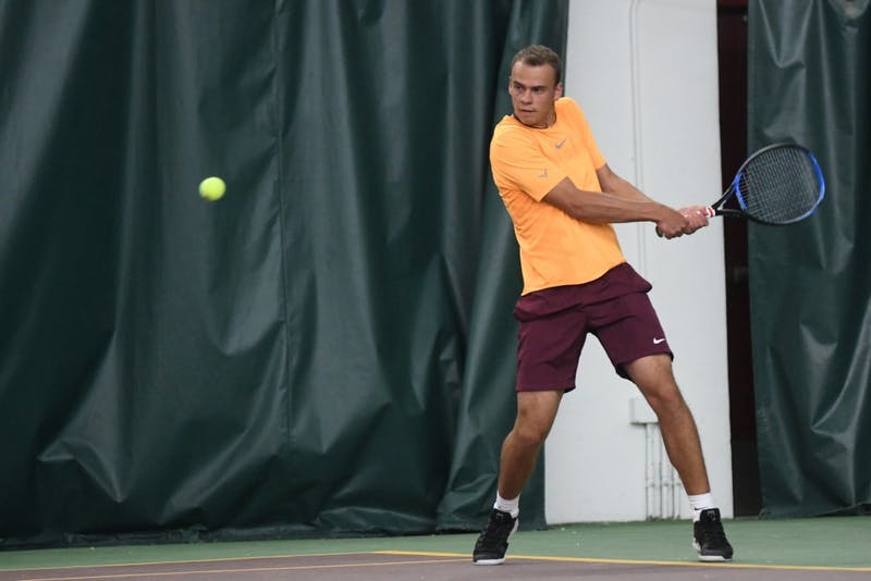 Sophomore Vlad Lobak prepares to return the ball on Friday, March 22 at the Baseline Tennis Center.