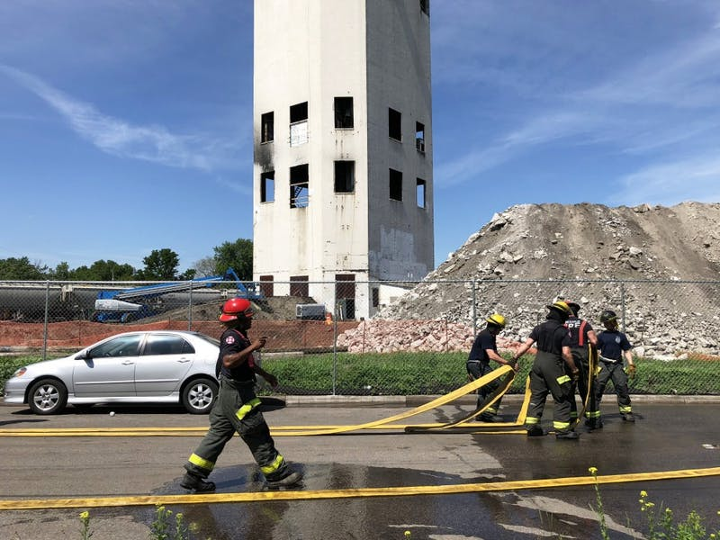 Firefighters put out flames at Bunge Tower on Friday, June 1, 2018 in the Southeast Como neighborhood.