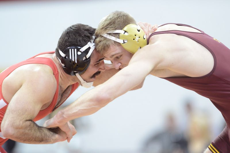 Nebraska's Dustin Williams takes on junior Nick Wanzek at the Sports Pavilion on Friday, Jan. 20. The Gophers lost 11 - 21 against the Huskers.