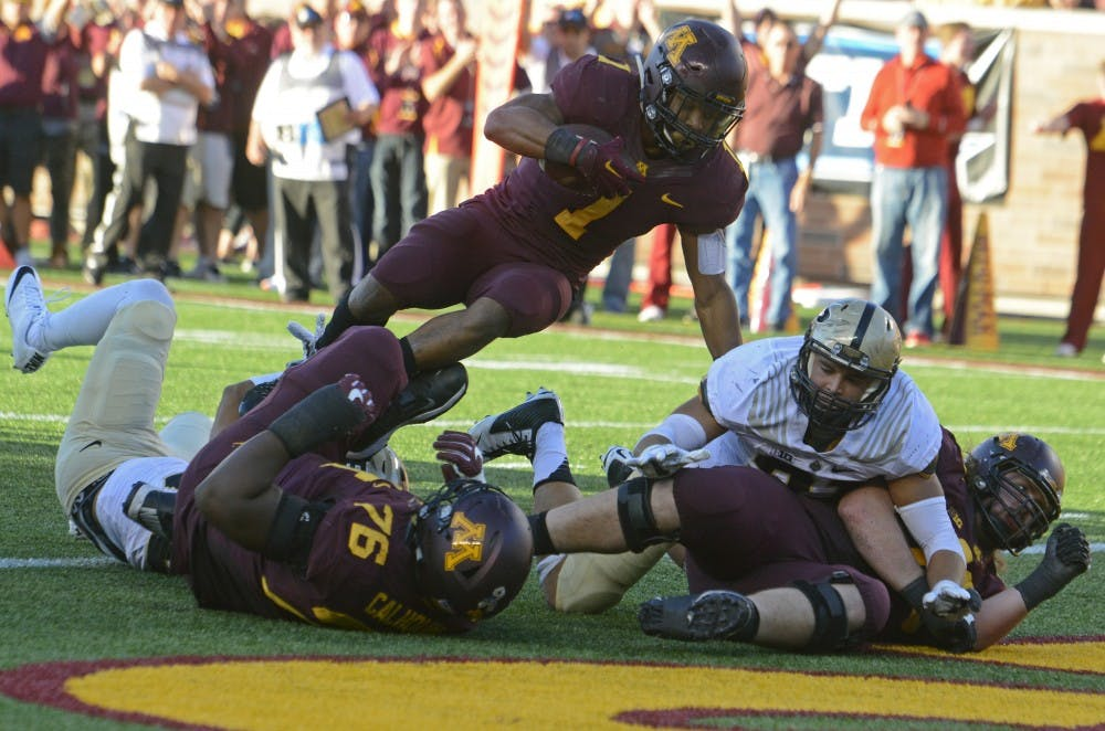 Minnesota defeats Purdue 44-31 behind career day from Smith