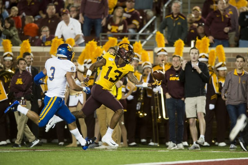Wide receiver Rashod Bateman reaches to catch a pass at TCF Bank Stadium on Thursday, Aug. 29. Minnesota defeated South Dakota State 28-21.