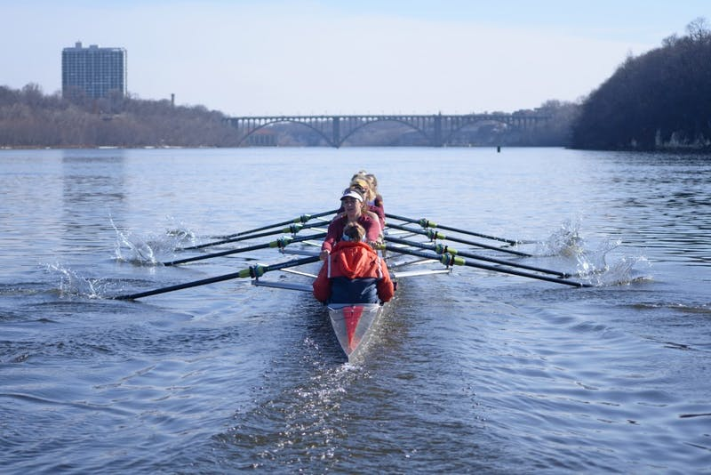 The University of Minnesota rowing team practices on Tuesday, March 27 on the Mississippi River.