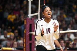 Junior Alexis Hart celebrates after the gophers scored against Iowa on Friday, Oct. 19, 2018 at Maturi Pavilion.