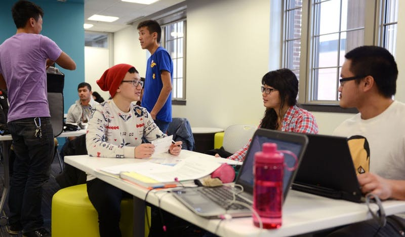 Hmong Minnesota Student Association members, vice president Kue Thao, secretary Shuazong Vang and Jimmy Her, gather in the multi-use space on the second floor of Coffman Memorial Union on Wednesday afternoon. The group had its own space last year but lost it after the floor's renovation.