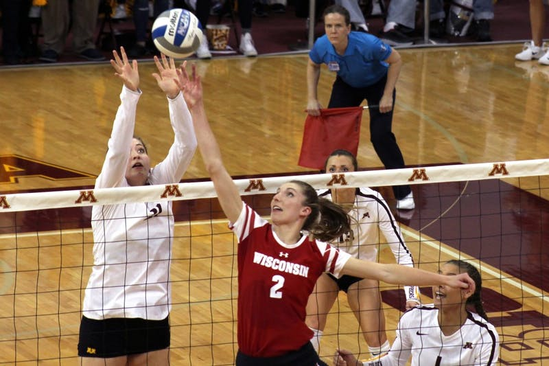 Middle Blocker Regan Pittman hits the ball at the volleyball game against the UW-Madison Badgers at the Maturi Pavilion on Oct 21, 2017.