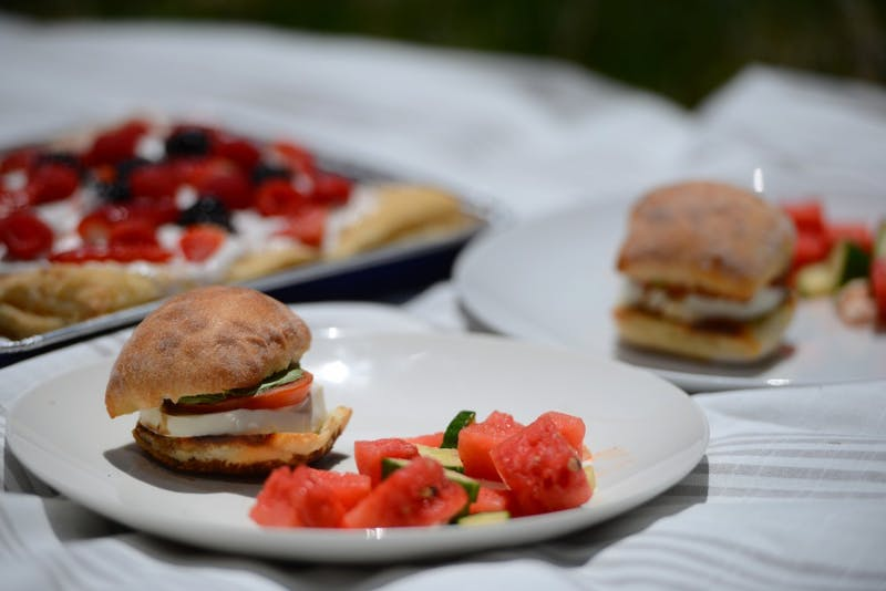The Minnesota Daily made caprese sandwiches with watermelon, feta and cucumber salad for the College Kitchen series. Dessert was a berry puff pastry with Cool Whip frosting.
