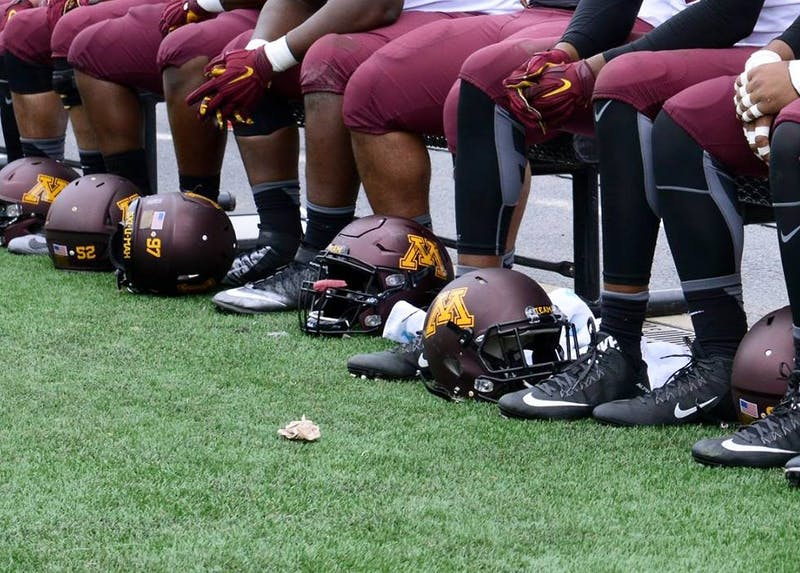 Gophers football players sit on the sidelines during a game at TCF Bank Stadium on Oct. 3, 2015.
