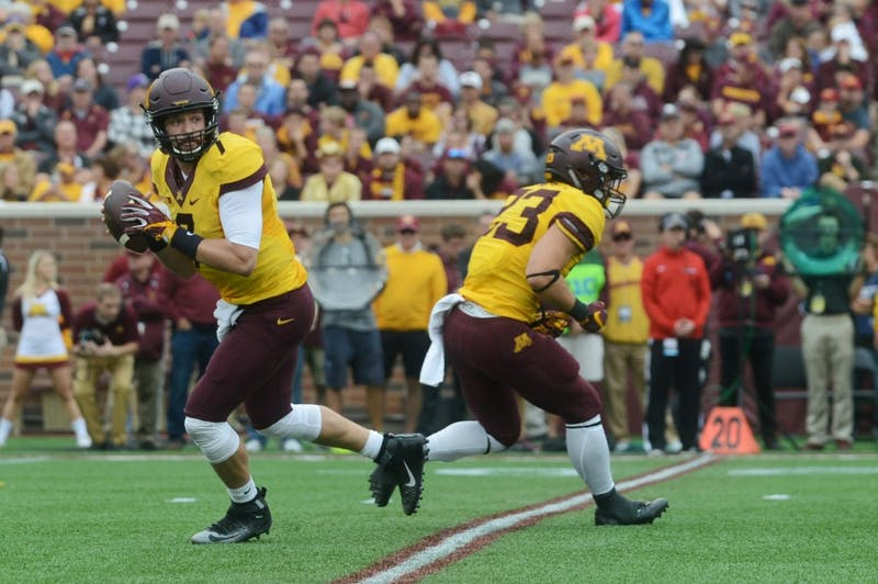 Gophers quarterback Mitch Lender prepares to pass the ball on Saturday, Sept. 24, 2016 at TCF Bank Stadium.