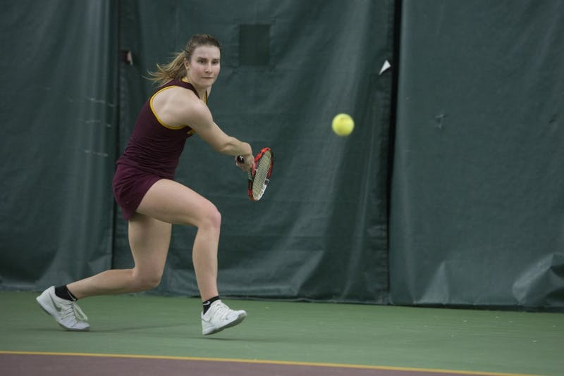 Senior Caroline Ryba competes in her singles match against the University of Michigan at Baseline Tennis Center on Friday, March 23.