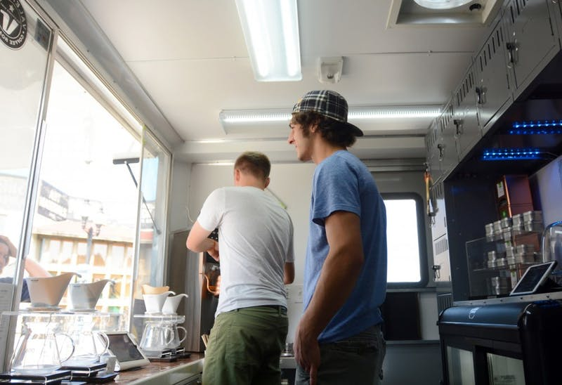 Alex Boehm (left) and Marcus Parkansky, cofounders of Misfit Coffee Company, prepare orders for customer on Tuesday in Dinkytown.