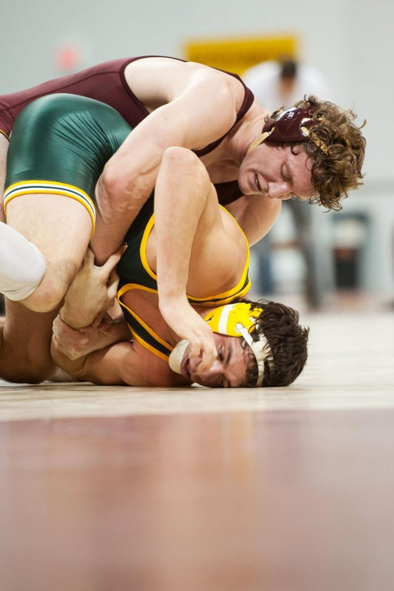 Minnesota's Kevin Steinhaus (184) attempts to get a hold on North Dakota State's Mac Stoll during their match Sunday at the Sports Pavilion.