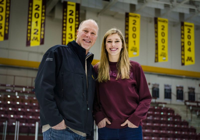 Rachel Ramsey and her father Mike Ramsey at Ridder Arena on Sunday. Mike Ramsey played hockey at the University of Minnesota for a season before making the 1980 Olympic Hockey Team. His daughter Rachel is a junior defenseman on the Gopher women's hockey team and her younger brother Jack signed a national letter of intent to play for the Gophers next year.