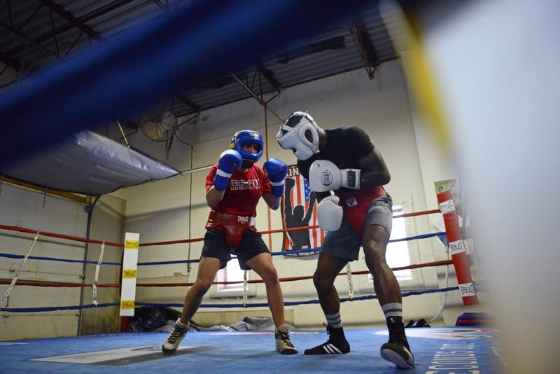 Caleb Truax, left, spars against Ronald Mixon during practice at Anoka Coon Rapids Boxing Gym on Tuesday, March, 20.