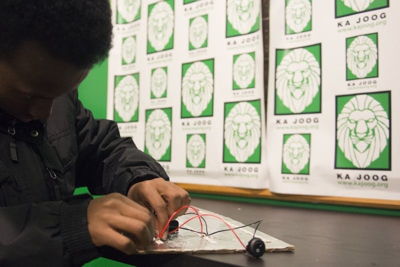 Nuredin Dahir works on lighting LED lights at the Ka Joog mentorship program in the Riverside Mall on Nov. 5, 2016. Ka Joog, a non-profit aimed at helping Somali youth, started the mentorship program in March and collaborates with University mentors to teach kids about STEM fields.