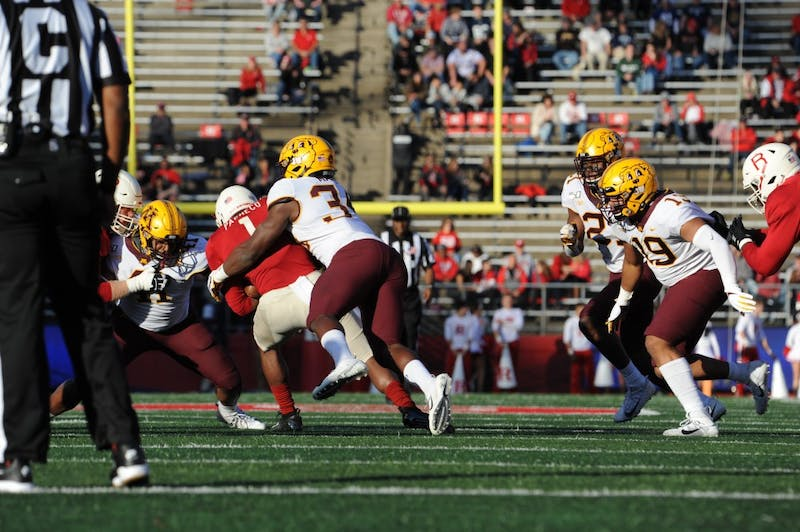 The Gophers tackle Rutgers' ball carrier at SHI Stadium on Saturday, Oct. 20. They defeated the Scarlet Knights 42-7 bringing their record to 7-0. (Courtesy of Dustin Niles / The Daily Targum)