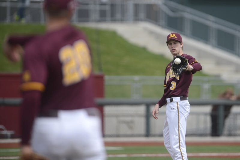 Toby Hanson throws the ball back to pitcher Brett Schulze during the Gopher's game against Illinois on Saturday, April 29, 2017 at Siebert Field.