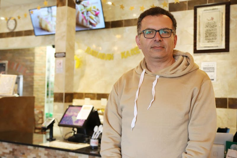 """Wally Sakallah poses for a portrait inside Wally's Falafel and Hummus, one of the businesses he owns, on Wednesday, May 1. """"It's all the about the family business,"""" he said. """"The family recipes they used back home, they brought here, and didn't change anything so it tastes like home."""""""
