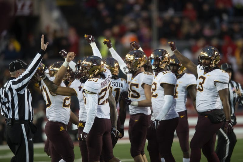 Gopher defense celebrates a fourth down stop at Camp Randall Stadium in Madison on Saturday, Nov. 24. The Gophers beat the Badgers 37-15 for the first time since 2003.