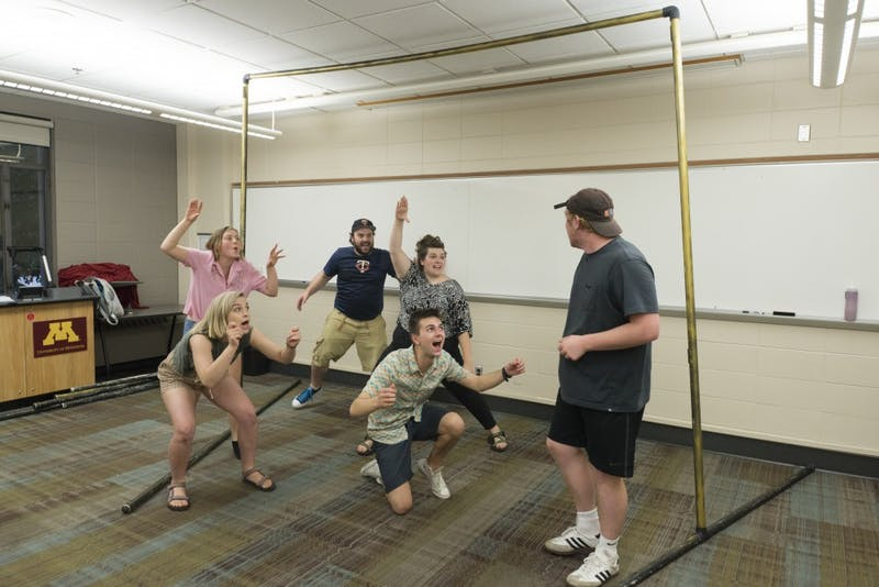 "The cast of ""Wonder and Awe: a Play about Magic,"" rehearses in Blegen Hall on Monday, July 23. The production will feature futuristic magic, comedy, and puppets and premieres on August 3 for the Minnesota Fringe Festival."