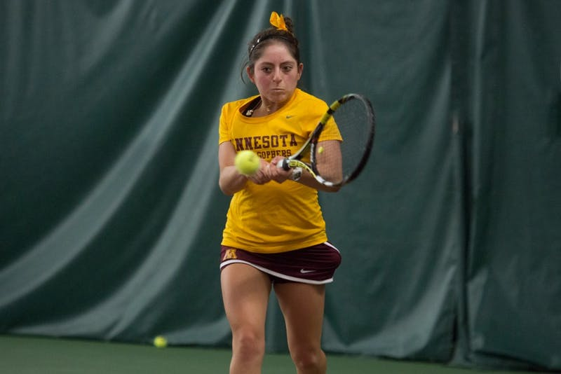 Camila Vargas Gomez returns a shot during a match against Michigan State University Friday at Baseline tennis center. The Gophers defeated Michigan State University 5-2.