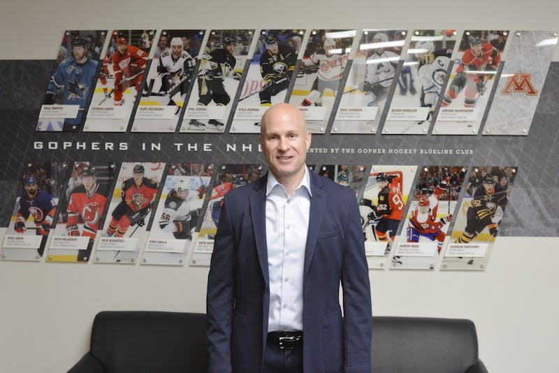 New assistant hockey coach Scott Bell poses for a portrait in Mariucci arena on Tuesday, June 20.