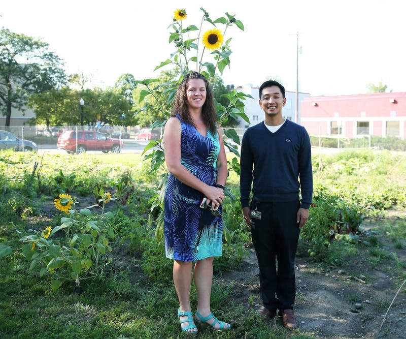 Adult Rehabilitative Mental Health Services program manager, Melissa Flores Floravanti, and practitioner Peter Dinh, pose in the new garden at the Community-University Health Care Center. The new garden will be used by mental health patients in the clinic as a place to relax and socialize.
