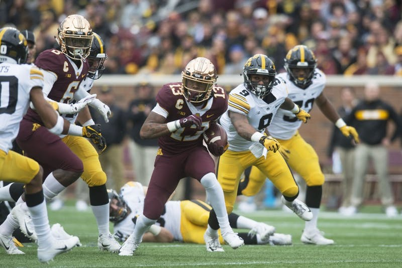 Wide receiver Rashod Bateman runs after a catch on Saturday, Oct. 6 at TCF Bank Stadium. The Hawkeyes defeated the Gophers 48-31.
