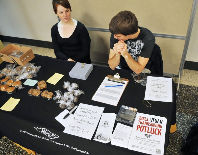Sophomore Mary Musielewicz and senior Jake Nath sell items Tuesday during their vegan bake sale at Coffman Union.  Musielewicz and Nath are student officers for Compassionate Action for Animals, a group that works to promote respect for animals and vegetarianism in the Twin Cities.