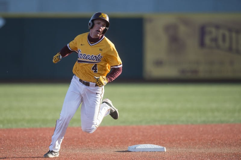 Catcher Eli Wilson rounds second base at Siebert Field on Friday, March 29.