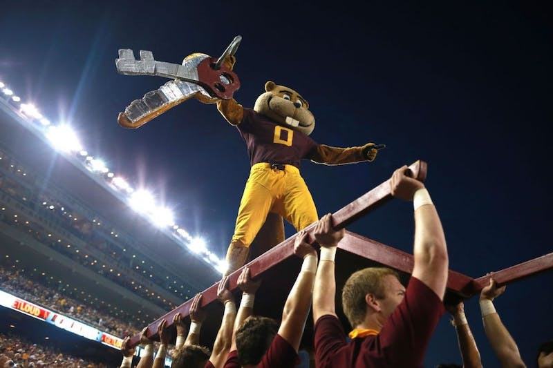 Goldy Gopher pumps up the crowd during kick off at TCF Bank Stadium as the Gophers face Texas Christian University on Sept. 3, 2015.