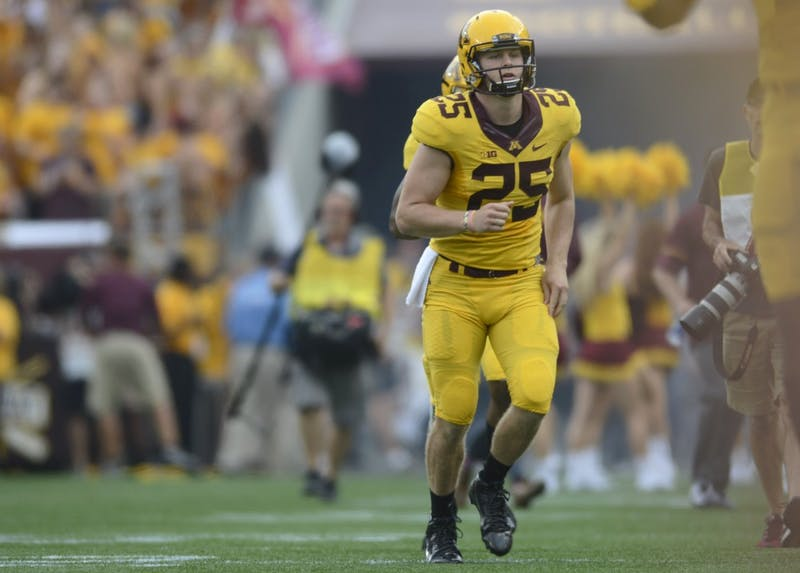 Long snapper Payton Jordahl runs onto the field before a game against Middle Tennessee at TCF Bank Stadium on Sept. 16.