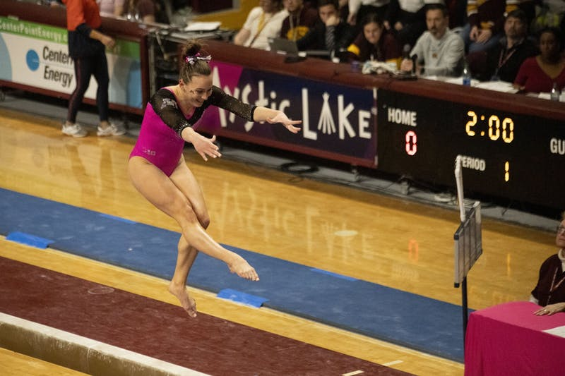 Junior Lexy Ramler competes on the beam during the Gophers' meet against the University of Illinois, which they won with a score of 196.300 to 195.225, at the Maturi Pavillion on Saturday, Jan. 25. Ramler went on to score her second perfect 10 in two weeks.