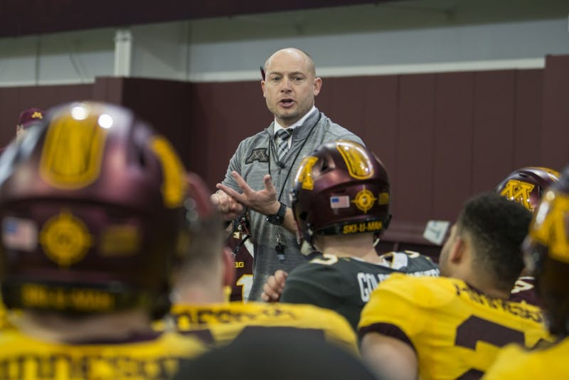 Head coach P.J. Fleck talks to the team on Saturday, April 13 in the indoor football practice facility in Athlete's Village.