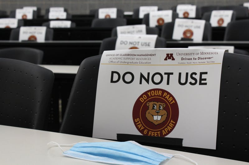 Social distancing signs flag down seats in Hanson lecture halls on Tuesday, July 28 at the University of Minnesota in Minneapolis. All classes during July-mester are enforcing social distance protocols.