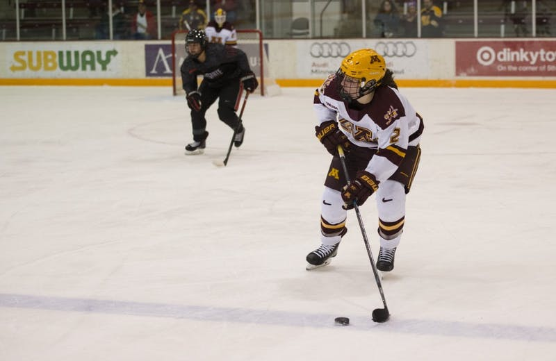Defender Emily Brown looks to pass the puck up the ice at Ridder Arena on Friday, Oct. 19. The Gophers beat Ohio State 3-0.