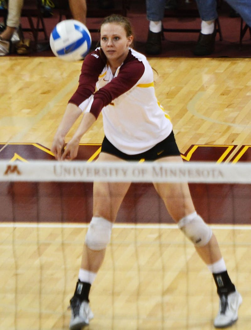 Gophers outside hitter Karlie Hauer passes the ball during a match Saturday, Sept. 28, 2013, at the Sports Pavilion.