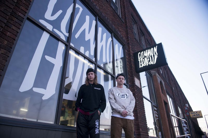 """Nate Blomquist, left, and Colton Allen, right, who own the apparel shop """"Common Apparel"""" pose for a portrait on Friday Nov, 22."""