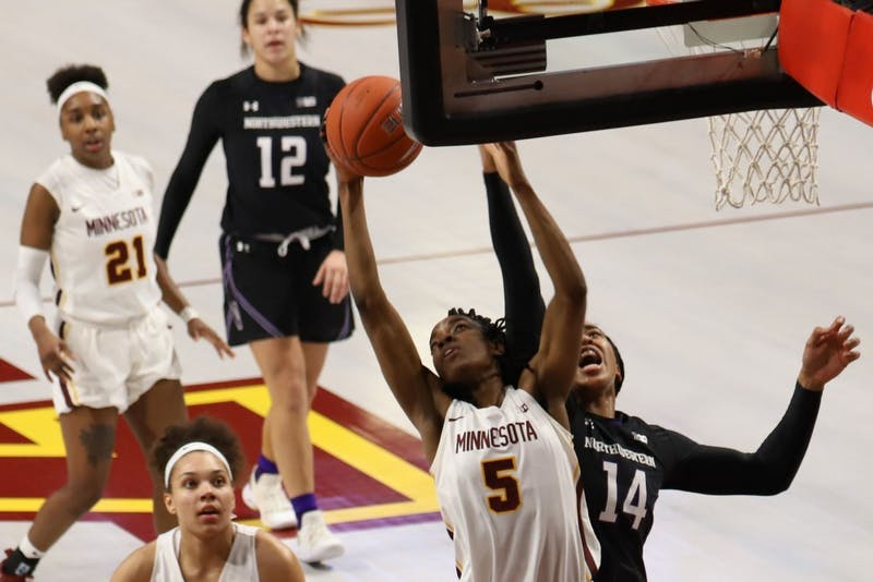 Junior Taiye Bello goes up to shoot during the Gopher game against Northwestern on Sunday, Feb. 10 at Williams Arena.