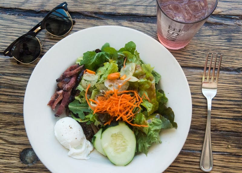 """Wise Acre Eatery's """"Shades of Asia"""" salad with blueberry aronia, paired with rhubarb basil soda."""