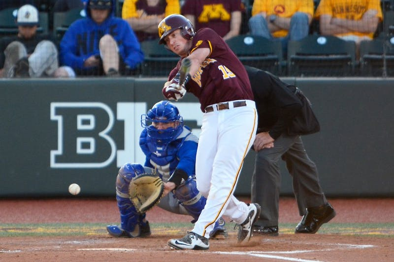 Minnesota catcher Austin Athmann swings at a pitch from Kansas State in Siebert Field on Tuesday evening. The Gophers beat Kansas 19 to 7 with 23 hits.