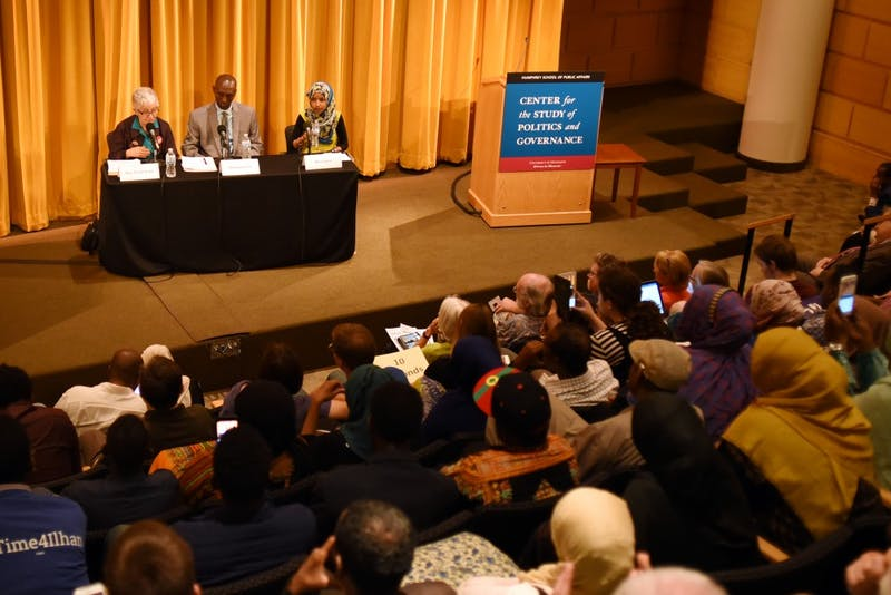 Minnesota Rep. Phyllis Kahn, Mohamud Noor and Ilhan Omar debate in a filled Cowles Auditorium at the Humphrey School of Public Affairs Monday evening. The three are competing for the DFL primary for House Seat 60B.